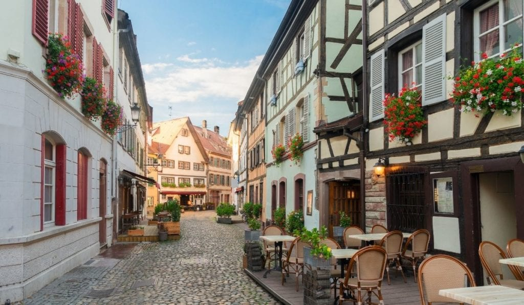 One of the best day trip from Paris - Strasbourg, Old Town, with half timbered houses and flower boxes lining the windows.