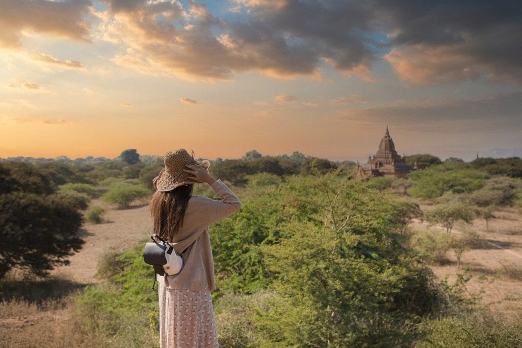 Female traveler in Bagan approaching a temple.