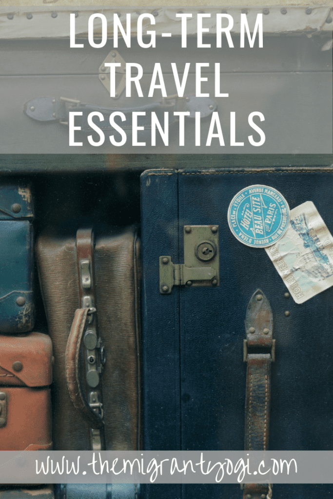 Pinterest graphic - old suitcases lined up with text 'long term travel essentials'.