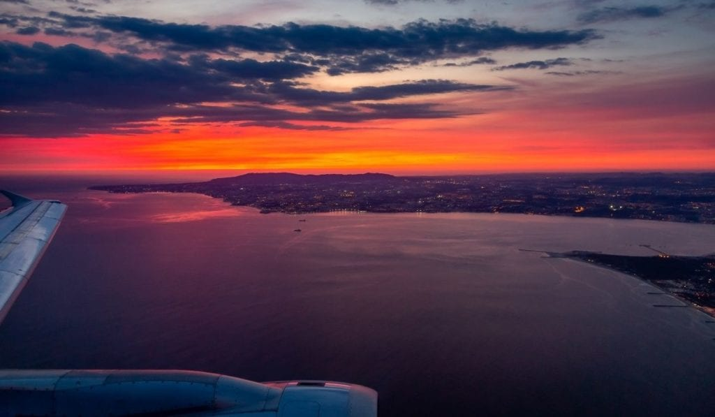 View of vivid sunset from airplane window.