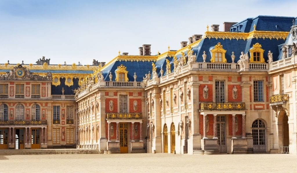 Vibrant external façade of the palace of Versailles, one of the easiest day trips to take from Paris.