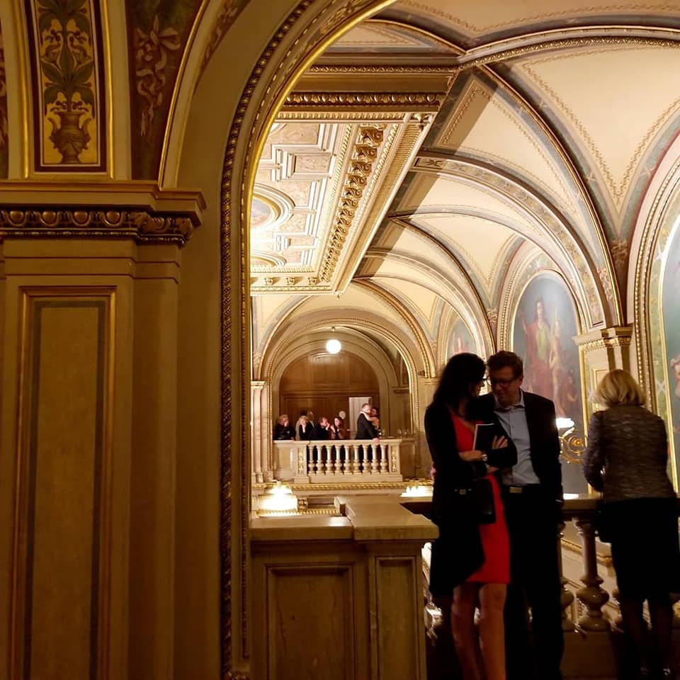 Couple at Vienna State Opera canoodling in a corner.