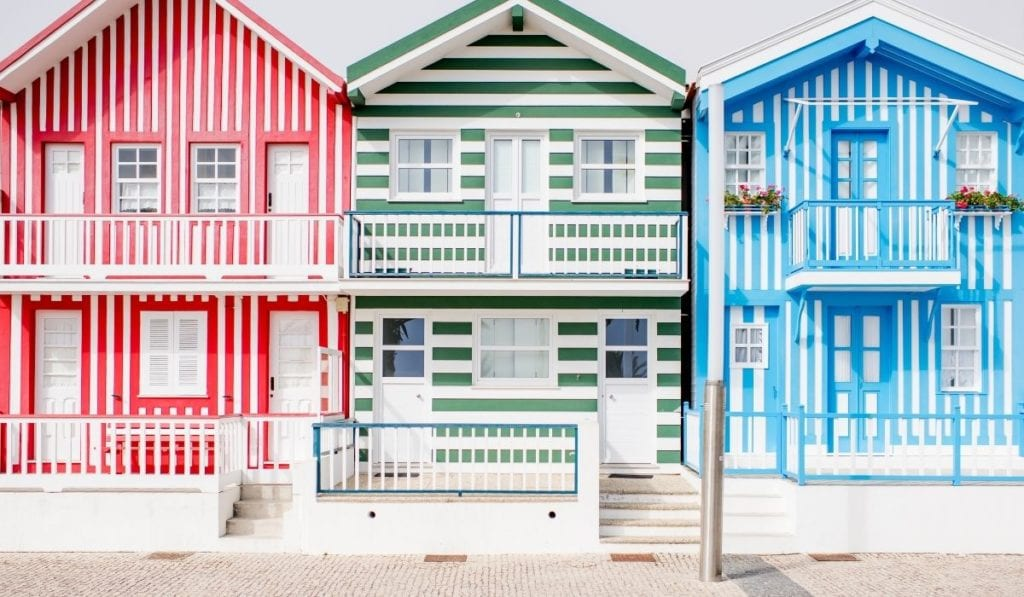 Iconic red, green, and blue striped houses of Aveiro, Portugal, one of the best day trips from Porto.