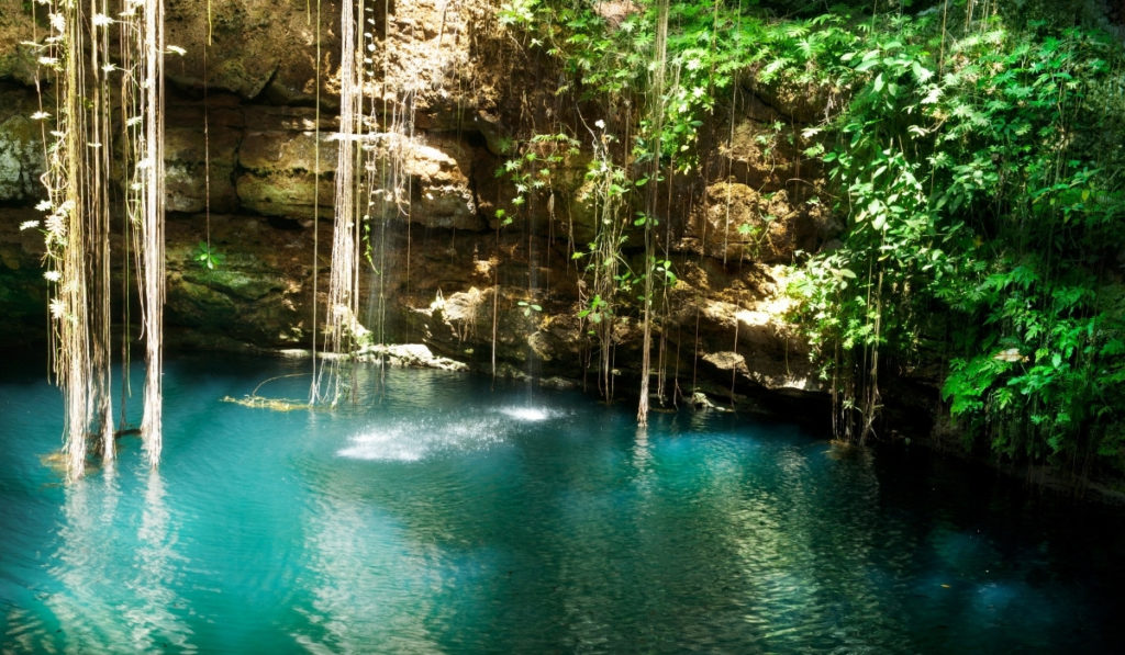 The turquoise blue waters of Cenote Ik Kil in Riviera Maya.