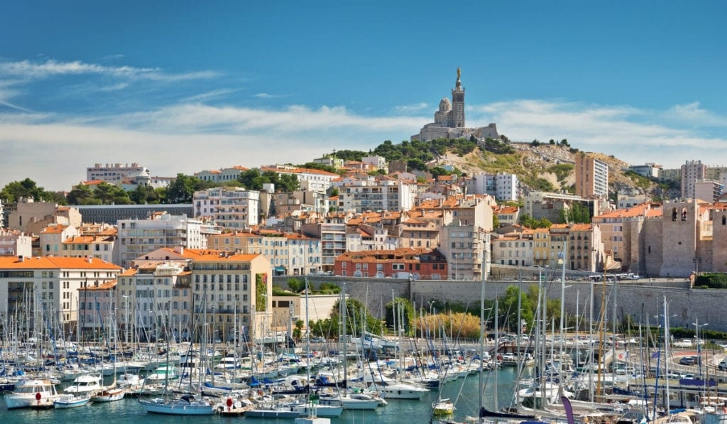 Port city of Marseilles, France, with hundreds of boats docked at port.