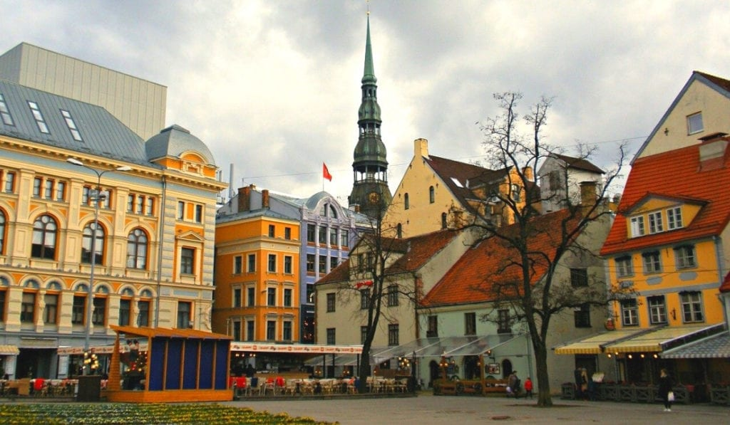Colorful buildings under cloudy skies in Riga, Latvia.