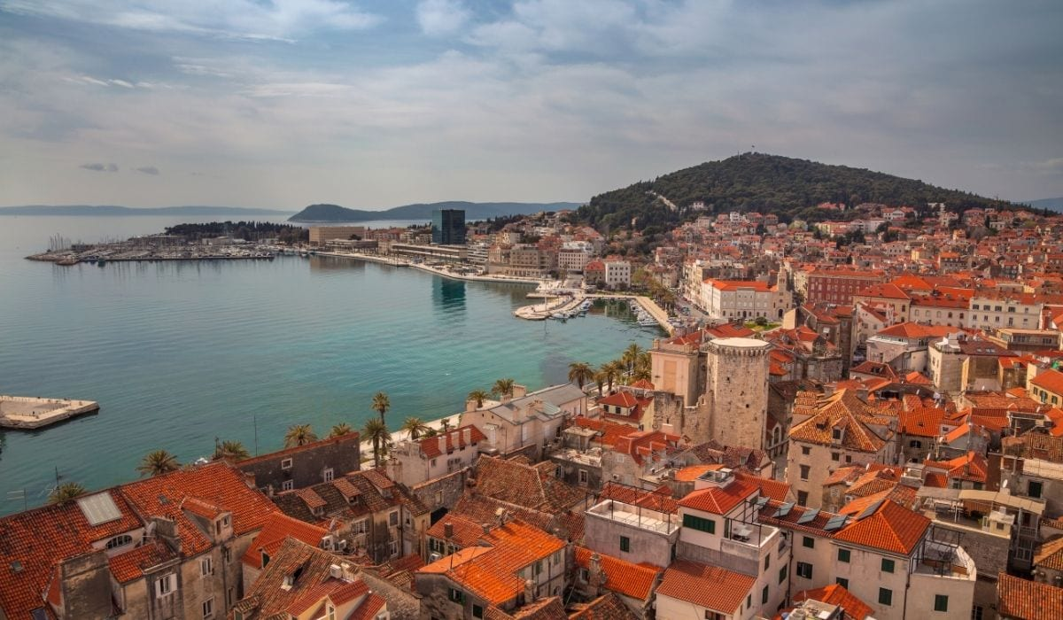 Aerial view of red rooftops and turquoise waters in Split, Croatia