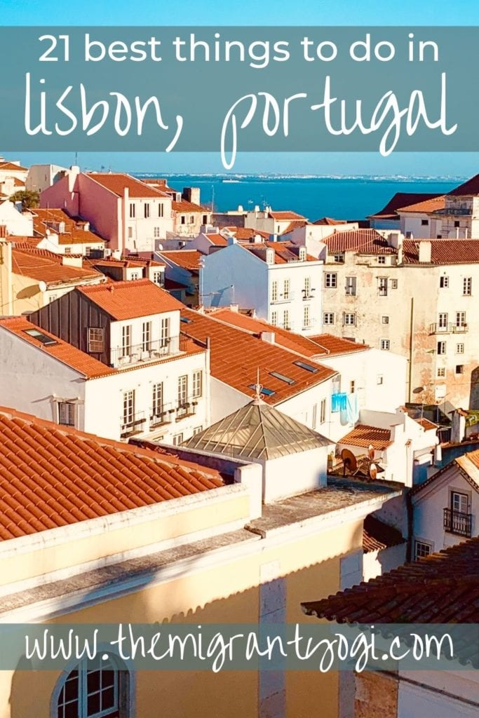 Pinterest graphic - 21 Things to do in Lisbon, Portugal with Alfama rooftops in image.