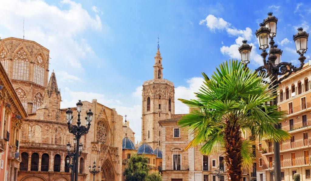 Gorgeous stone buildings and palm trees in Valencia, Spain