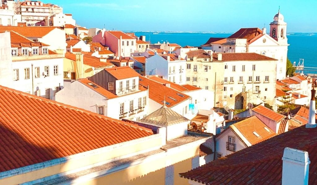 Red rooftops of the Alfama district in Lisbon, Portugal.