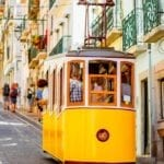 Famed bica funicular in Lisbon, Portugal on a colorful street.