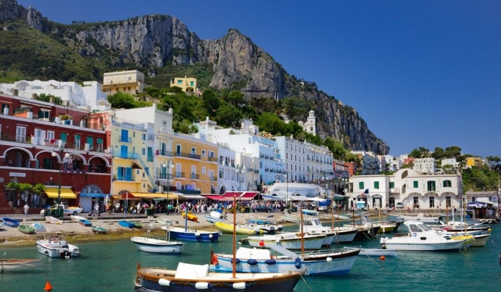 Many boats docked on the shores of Capri, Italy, one of the most beautiful European cities.