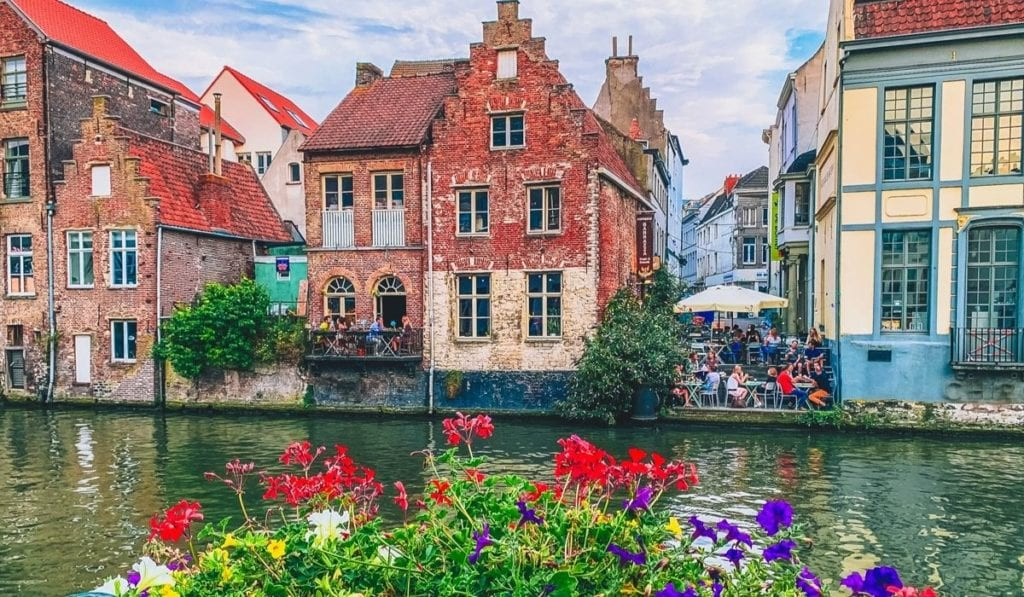 Gorgeous canal in Ghent, Belgium, with flowers in the foreground.