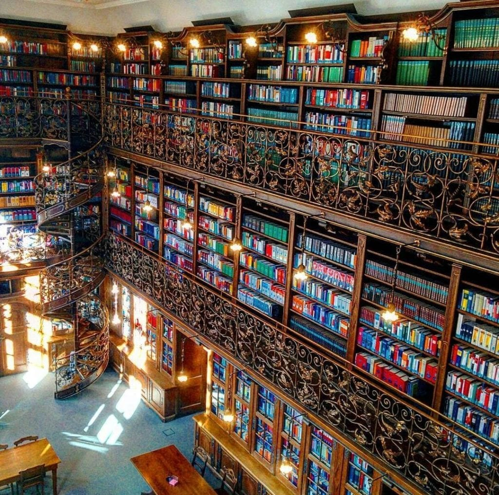 Colorful books line the walls of the most beautiful library in Munich.