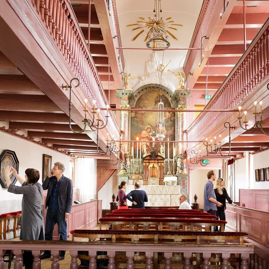 Pink Church interior, perfect instagram photo at one of the best museums in Amsterdam.