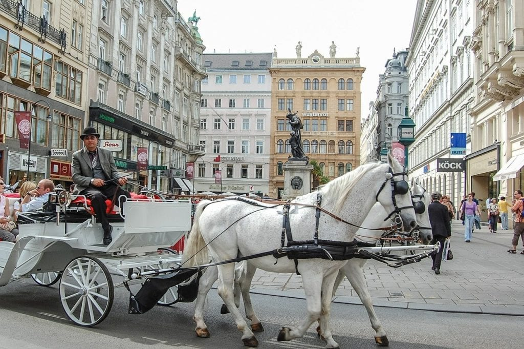 Horse-drawn carriage wandering the streets of Vienna.