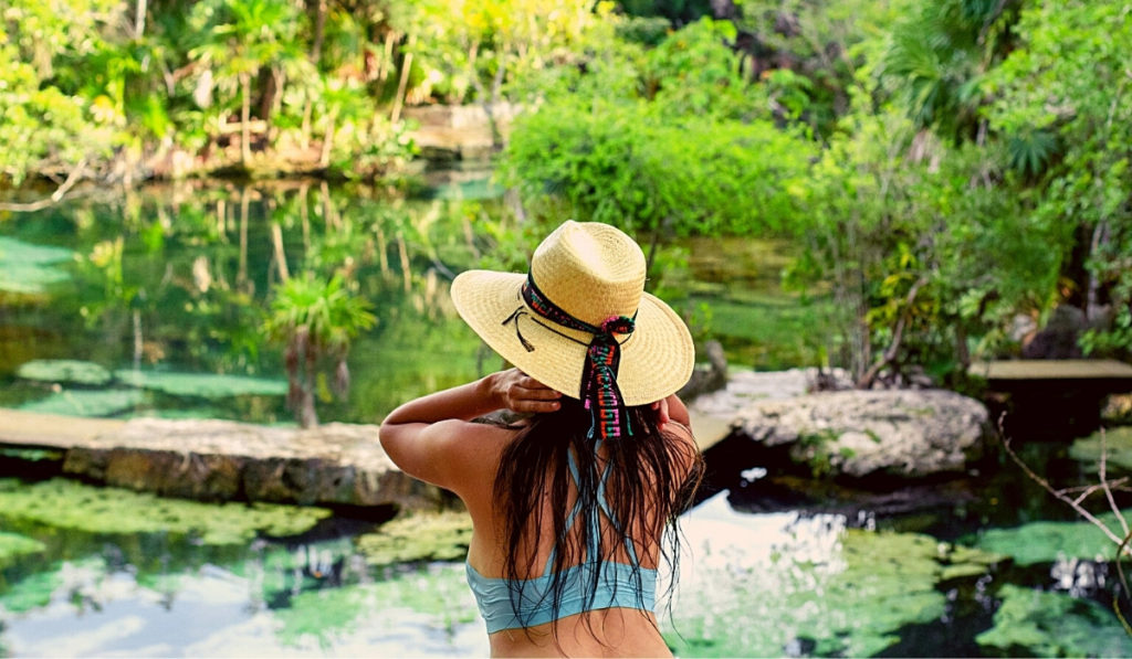Woman looking over one of the cenotes in Riviera Maya, Mexico.