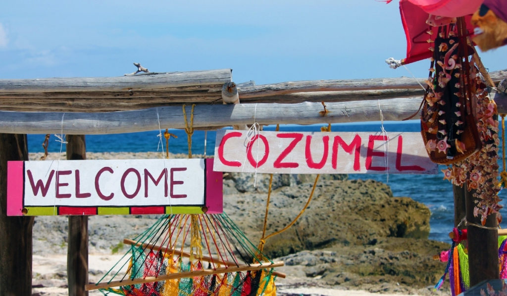 Colorful signs reading 'Welcome' and 'Cozumel' in Cozumel, Mexico.