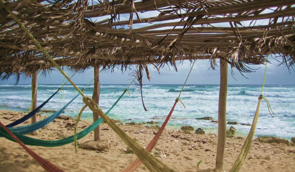 Empty beach hammocks on the beach of Cozumel, Mexico.